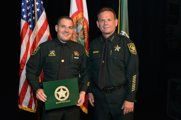 Detective Chris Williams w Sheriff Isreal
